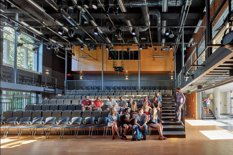 "A 200-seat ""black box"" auditorium classroom provides a platform for testing experimental teaching strategies, group interactive exercises, and virtual teaching-collaboration."